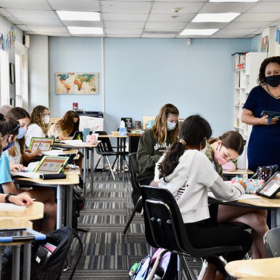 Teacher in middle school classroom